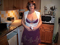 Mature with huge tits in kitchen.